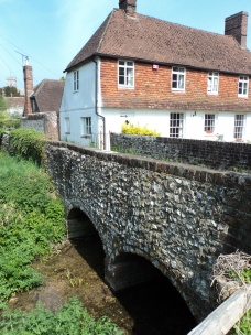 Old houses at West Meon by the side of the river and bridge