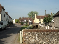 War Memorial and main street at East Meon