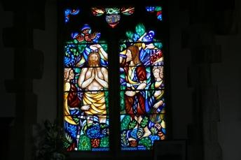 Stained glass windows inside St John the Baptist church New Alresford